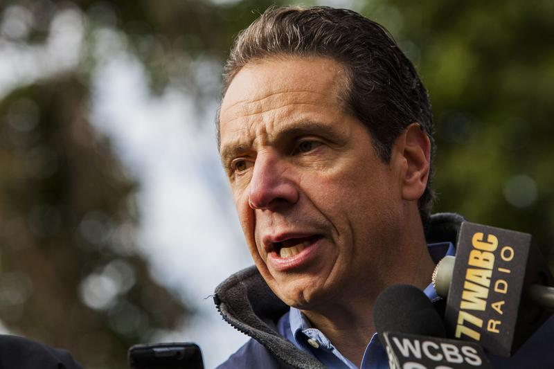 Gov. Andrew Cuomo talks to reporters in December 2013.