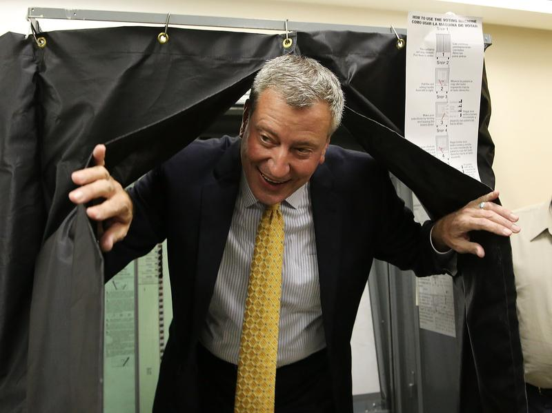 Democratic mayoral candidate Bill de Blasio emerges from a voting booth on Sept. 10