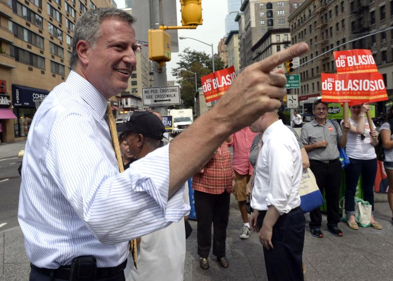 Bill de Blasio, New York City's public advocate and frontrunner among Democratic candidates for mayor, greets voters on the Upper West side along with his wife Chirlane McCray.