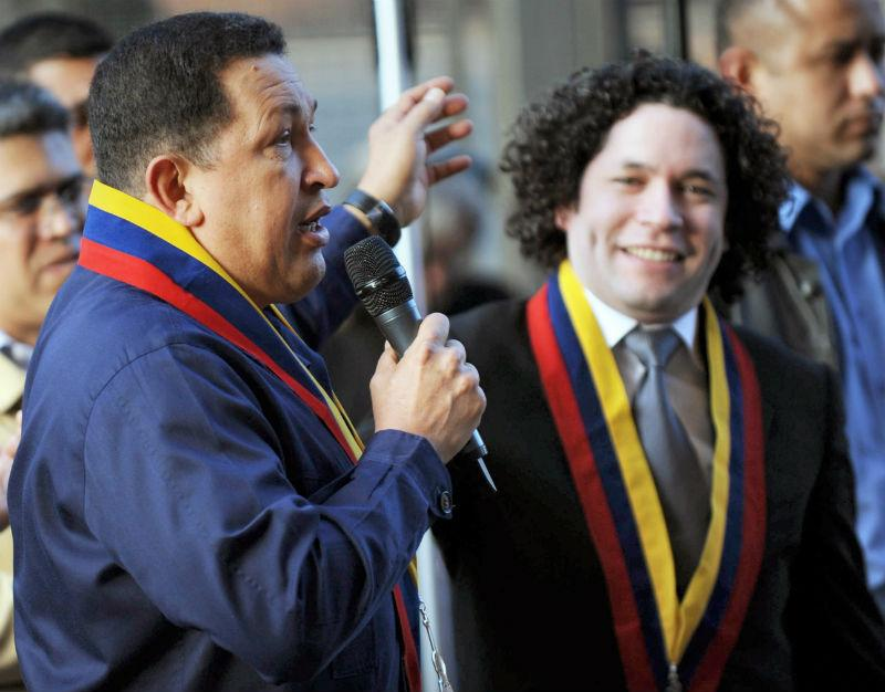 Hugo Chavez (L) speaks next to Gustavo Dudamel (R) in Caracas on Feb. 12, 2011