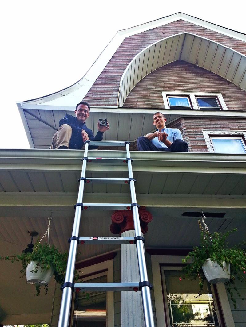 Fallacara and Dylan Rolleri take measurements on the Fishers' roof