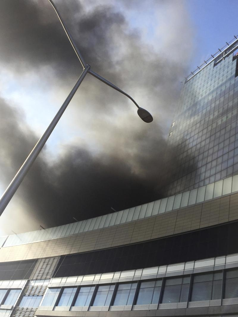 Smoke rises from a building under construction at the NYU Langone Medical Center on the east side of Manhattan in New York, Wednesday, Dec. 14, 2016.