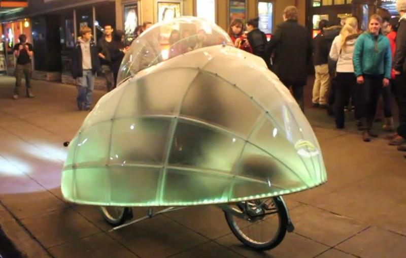The Firefly bike keeps you dry and glowing.