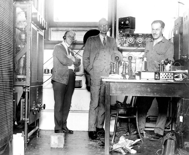 WNYC's  first day of broadcasting.  B.L. Davies, Public Service Operator [l] , Raymond Asserson, Chief Radio Engineer [c], and W. Stauber, Westinghouse engineer in charge of transmitter installation.