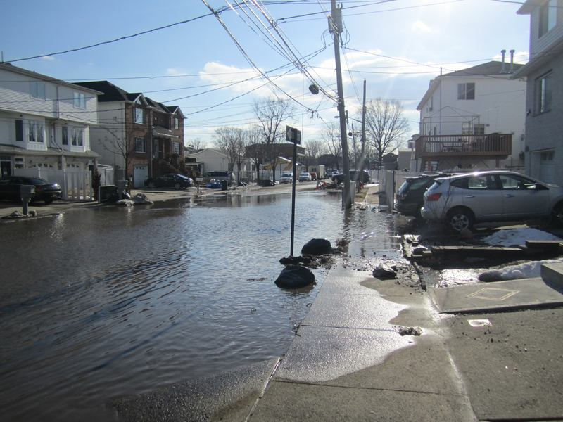 Flooding is common along parts of the coast even when a hurricane is not passing through. Above, a street in Midland Beach after snow melted last winter.