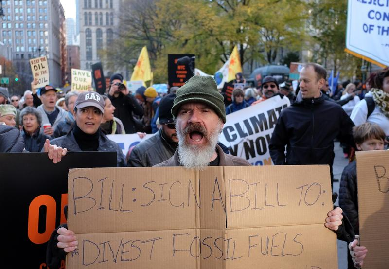 Environmental activists and supporters take part in a rally calling for action on climate change in New York on November 29, 2015, a day before the start of the COP21 conference in Paris.