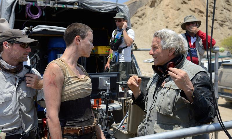 "Charlize Theron and director George Miller on the set of  ""Mad Max: Fury Road"""