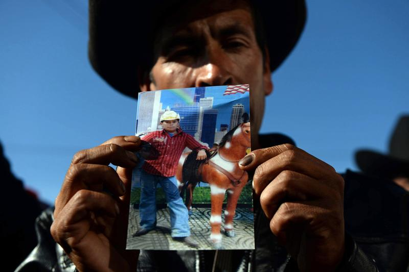 Guatemalan Francisco Ramos shows a picture of his son Gilberto Francisco Ramos, a 15-year-old boy who died in the Rio Grande Valley in Texas, while trying to reach the United States on his own.