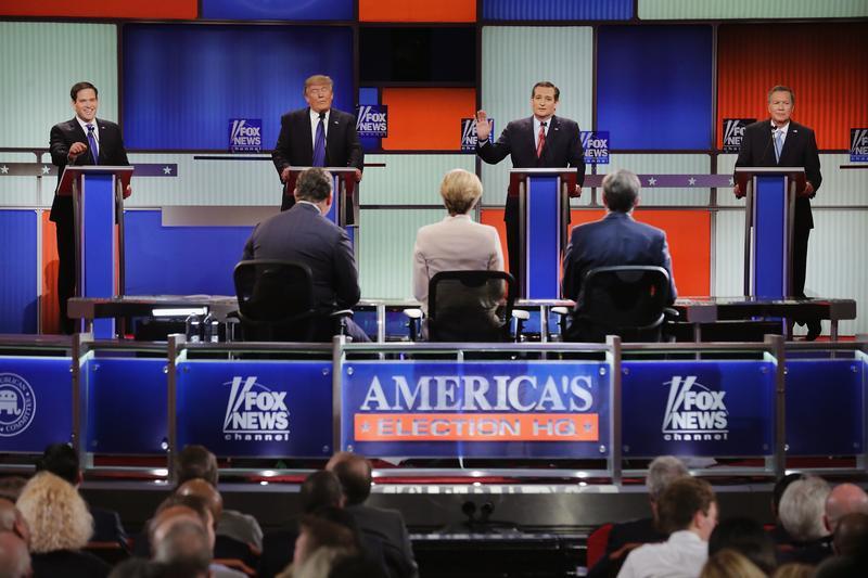 Republican presidential candidates (Lto R) Sen. Marco Rubio (R-FL), Donald Trump, Sen. Ted Cruz (R-TX), and Ohio Gov. John Kasich participate in a debate in Detroit, Michigan.