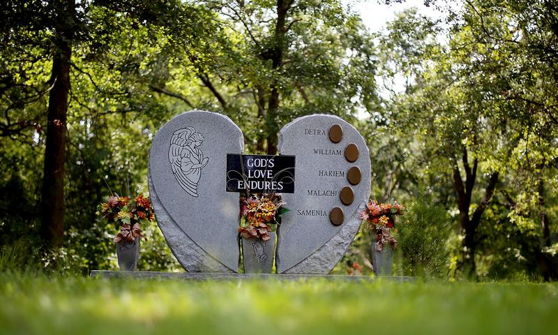 The gravesite of Detra Rainey, 39, and four of her children. They were shot to death inside their North Charleston home in 2006. Her husband was charged, but later declared mentally unstable.