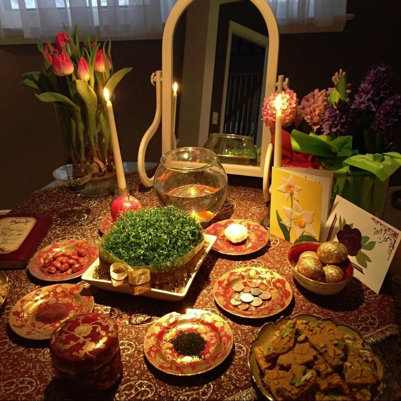 """The traditional """"haftseen"""" table for Nowruz, with objects that symbolize good fortune and well wishes for the new year."""