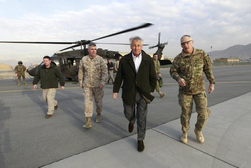 U.S. Secretary of Defense Chuck Hagel walks from a blackhawk helicopter as he ends his first trip to Afghanistan as Secretary of Defense.