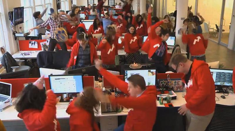 "An office staff dances as part of a ""Harlem Shake"" video."