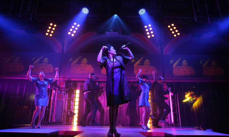 Ruthie Ann Miles (center) and the cast of <em>Here Lies Love</em>