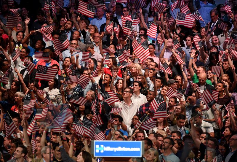 The crowds reacts as they watch monitors waiting for Democratic presidential candidate Hillary Clinton during her primary night event at the Brooklyn Navy Yard, June, 7, 2016 in New York.