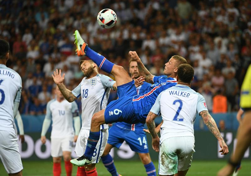 Ragnar Sigurdsson, second right, of Iceland competes during the Euro 2016 round of 16 football match between England and Iceland in Nice, France, June 27, 2016.