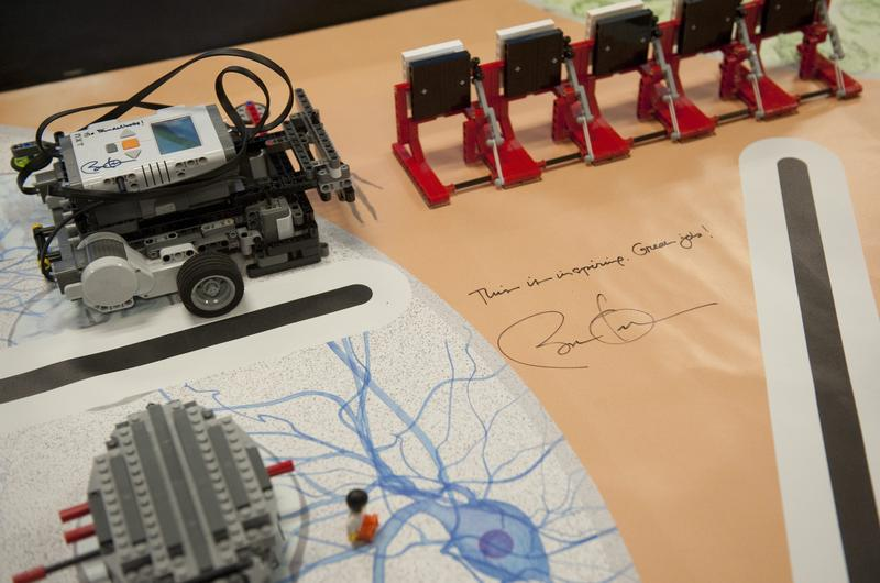 President Barack Obama's signature appears on a table holding experiments by Intel Science Talent Search finalists.