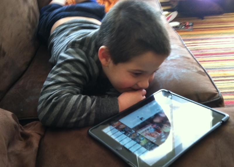 Five-year-old Quentin, who is autistic, uses an iPad to help him communicate