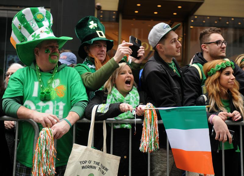 Spectators watch the New York City St. Patrick's Day Parade on 5th Avenue Tuesday.
