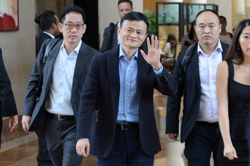 Alibaba founder Jack Ma waves as he leaves a hotel in Singapore on September 16, 2014 in advance of the company's upcoming IPO.