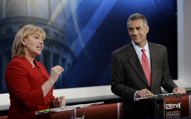 New Jersey Lt. Gov. Kim Guadagno, left, speaks as Assemblyman Jack Ciattarelli looks on during a Republican gubernatorial primary debate, Thursday, May 18, 2017, in Newark, N.J.
