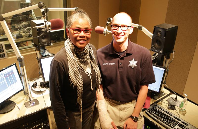 Jo Ann Allen stands next to sheriff's deputy Tom Finley, who mistook her golf bag for a rifle.