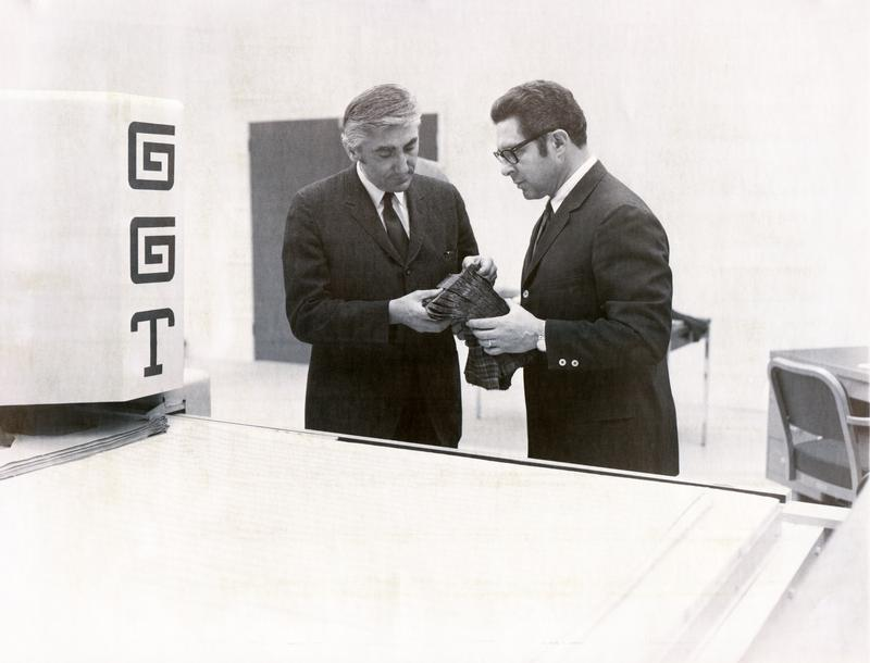 H. Joseph Gerber (left) with David Pearl, inspecting apparel parts