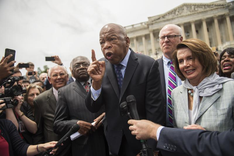 Rep. John Lewis, D-Georgia, along with other members, address demonstrators on the East Front of the Capitol after the House Democrats' sit-in over gun control legislation.