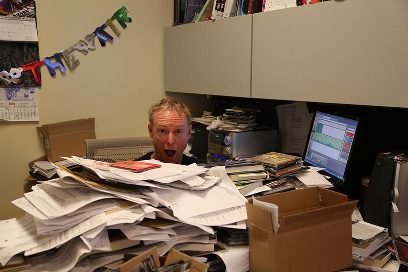 Soundcheck host John Schaefer, buried under a pile of CDs and press releases.