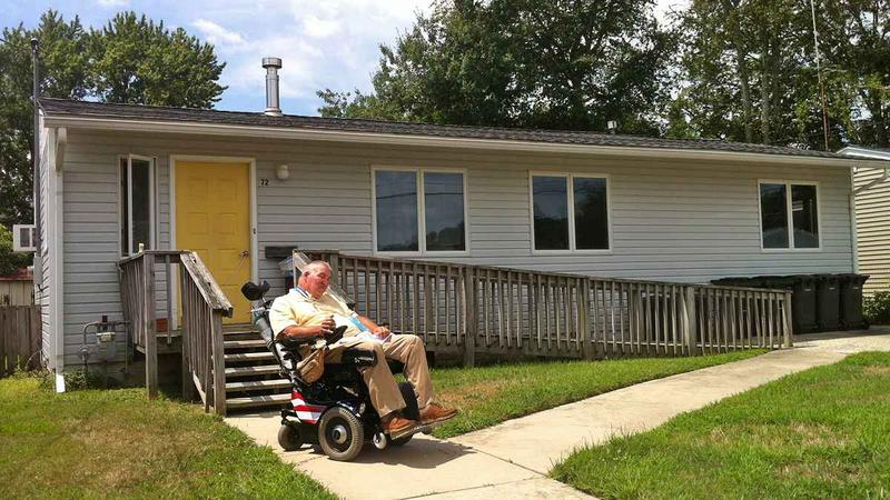 Richard West uses a long ramp just to reach his front door. (Tracey Samuelson/for NewsWorks)