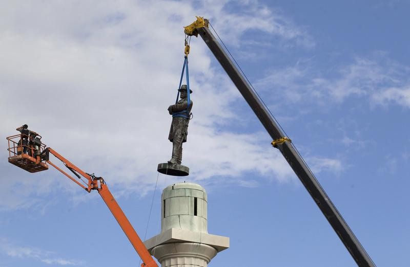 A statue of Confederate General Robert E. Lee is removed from Lee Circle Friday, May 19, 2017, in New Orleans.