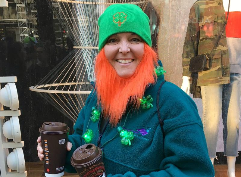 A parade-goer from Boston dressed as a Leprechaun