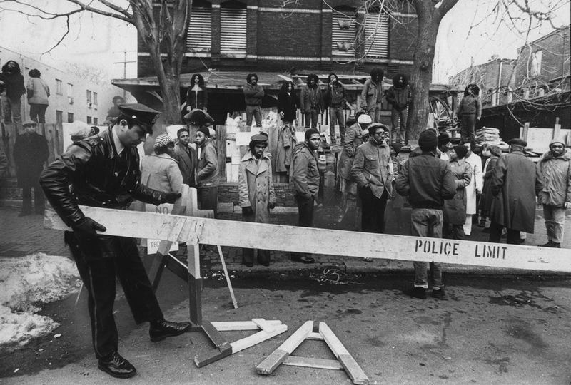 "MOVE members and police during the 1978 confrontation outside MOVE headquarters. ""Let the Fire Burn,"" a film by Jason Osder. A Zeitgeist Films release."