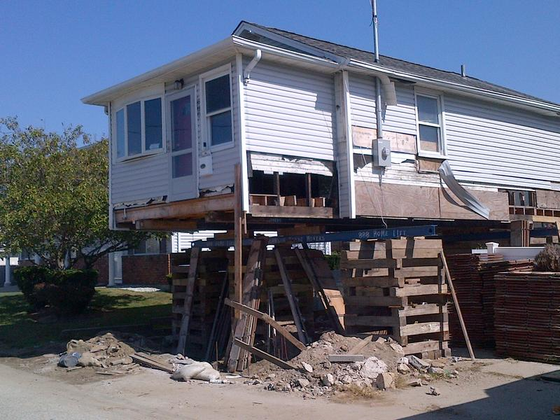 A house in a buyout area in Lindenhurst, on Long Island, in the process of being elevated to reduce flood risk.