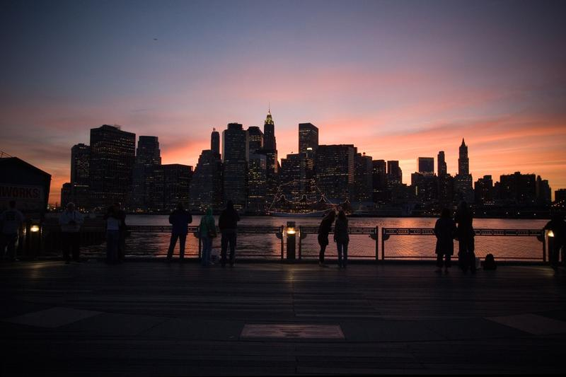 The sunset view of Manhattan from the Fulton Ferry Landing in Brooklyn (Dumbo) at the base of the Brooklyn Bridge.