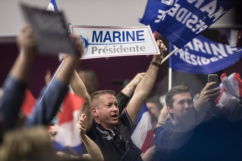 Supporters cheer presidential election candidate Marine Le Pen during a campaign meeting in eastern France.