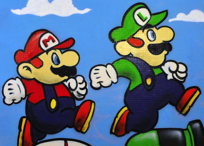 Graffiti piece of Nintendo's Mario and Luigi by an unidentified artist on a wall in the city centre on November 8, 2010 in Bristol, UK.