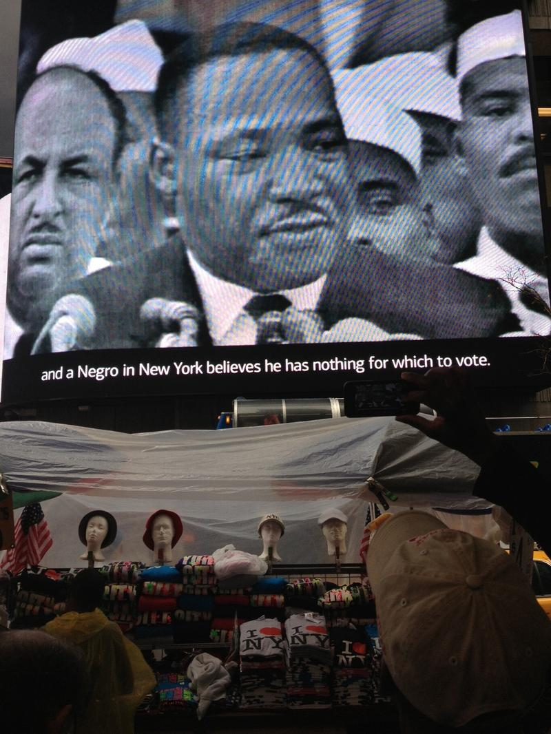 "People watch Martin Luther King Jr.'s ""I Have a Dream"" speech in Times Square"