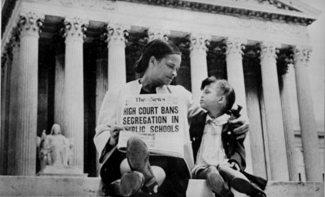 Mother and child on steps of Supreme Court following Brown v. Board of Education decision.