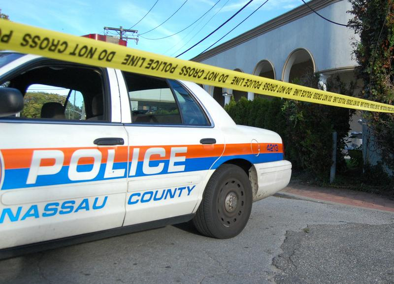 A Nassau County police car outside the shooting site in Garden City, NY