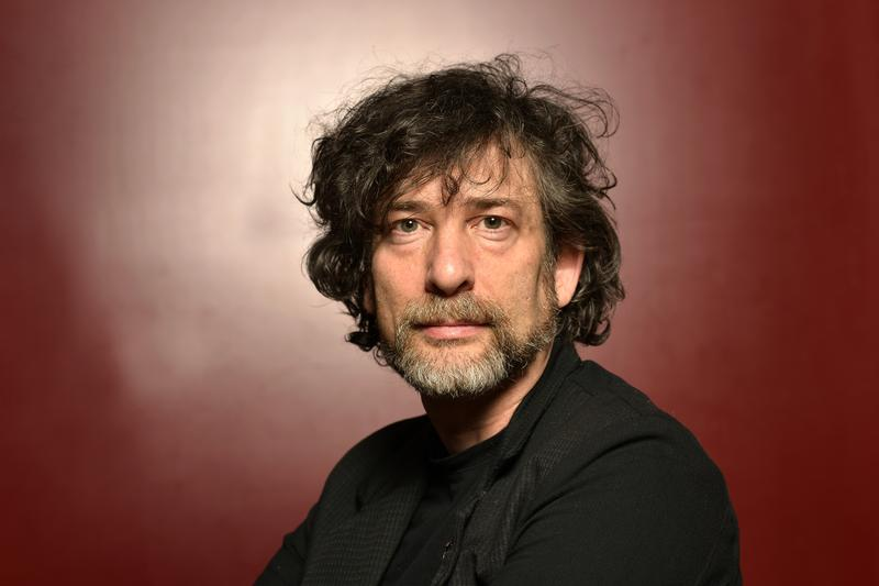 English writer Neil Gaiman poses during portrait session held on October 25, 2014 in Paris, France.