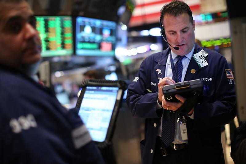 Traders work on the floor of the New York Stock Exchange on February 27, 2013 in New York City.