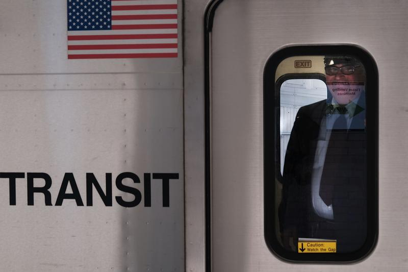 A train conductor stands inside of a NJ Transit train. Some light rail trains will soon be outfitted with video and audio recording devices intended to track criminal behavior.