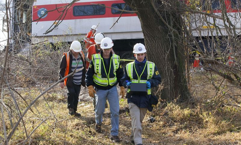 NTSB investigators retrieve an event recorder from the derailed Metro-North train in the Bronx.