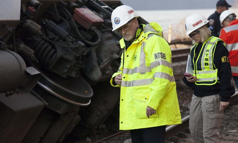 An NTSB investigator inspects the Metro-North track at the scene of the December 2013 train derailment.