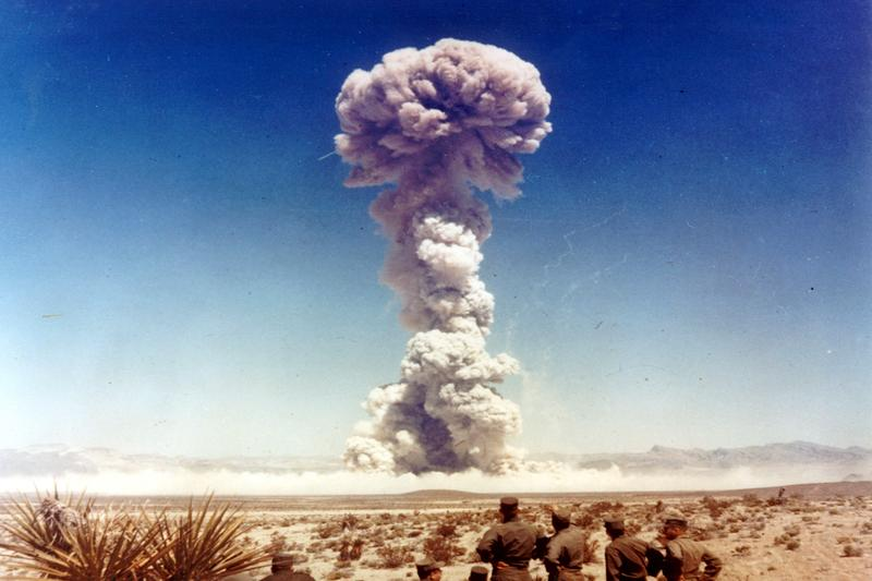 Military personnel observe a nuclear weapons test in Nevada, the United States, in 1951.