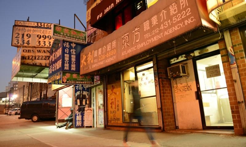 Chinatown is dotted with dozens of employment agencies and salons like these two operating next door to each other here.