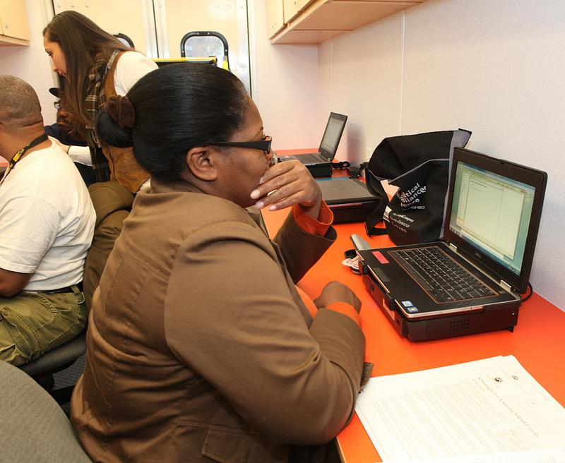 People access the internet in a NYCHA digital van.