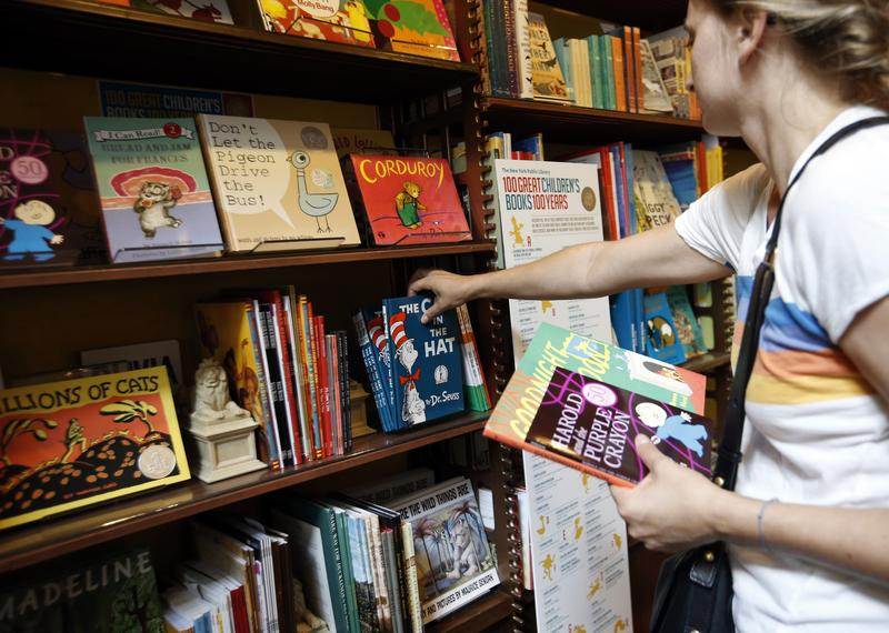 Anne Sophie Parigot searches for books for her 3 and 6-year-old children at the New York Public Library bookstore, Monday, Sept. 30, 2013.