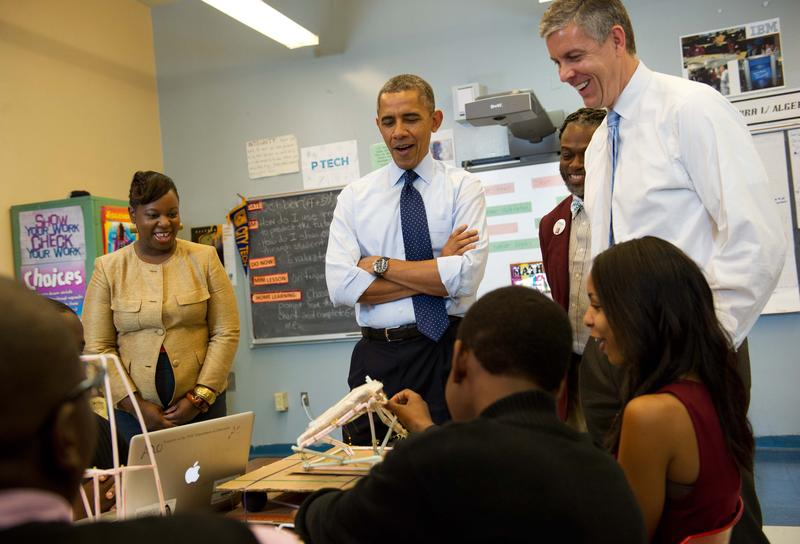 President Barack Obama visits a class at P-Tech with Education Secretary Arne Duncan and P-Tech principal Rashid Davis